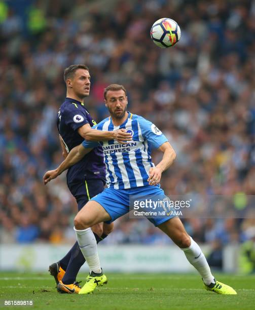 Phil Jagielka of Everton and Glenn Murray of Brighton and Hove Albion during the Premier League match between Brighton and Hove Albion and Everton at...