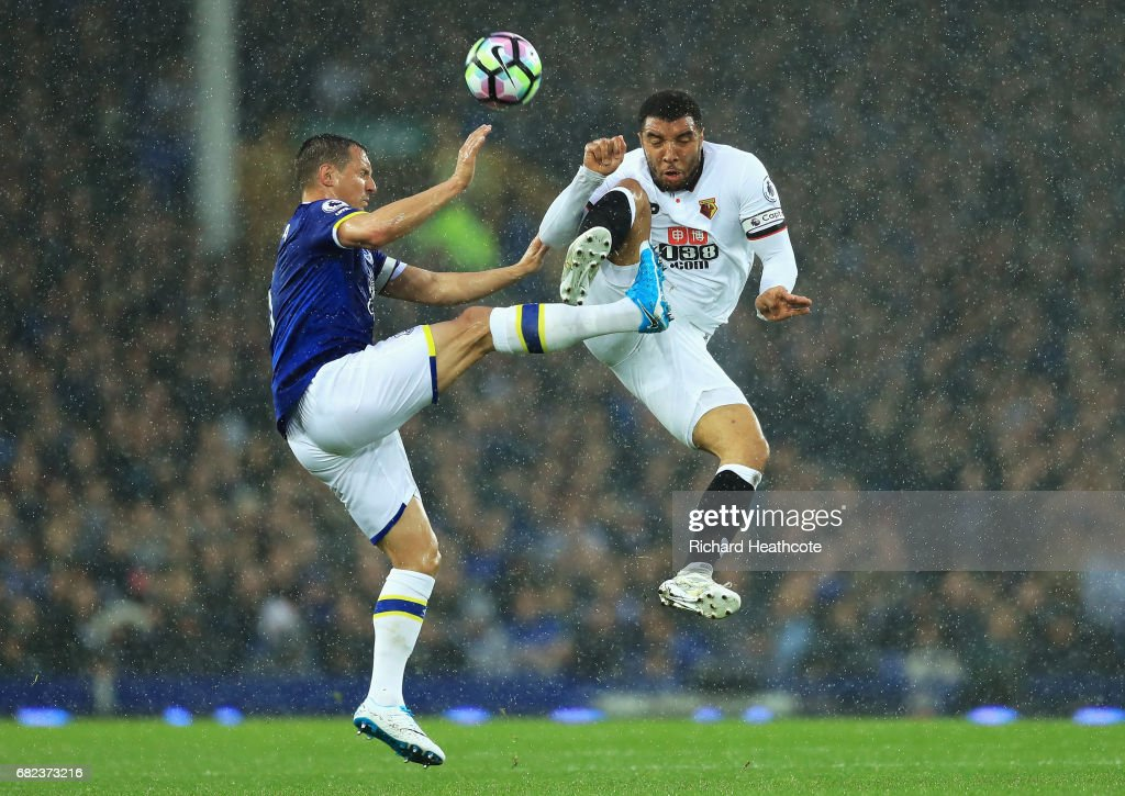 Phil Jagielka of Everton and Troy Deeney of Watford compete for the ball during the Premier League match between Everton and Watford at Goodison Park on May 12, 2017 in Liverpool, England.