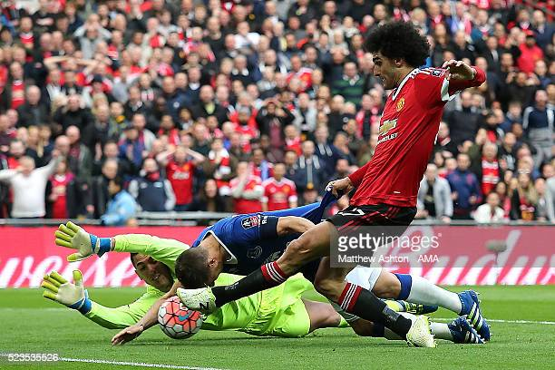 Phil Jagielka of Everton blocks the attempt on goal of Marouane Fellaini of Manchester United during the Emirates FA Cup Semi Final match between...