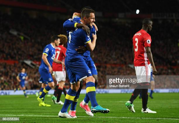 Phil Jagielka of Everton celebrates scoring his sides first goal during the Premier League match between Manchester United and Everton at Old...