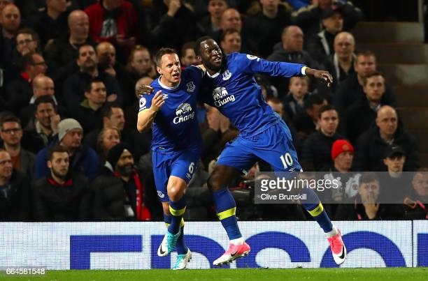Phil Jagielka of Everton celebrates scoring his sides first goal with Romelu Lukaku of Everton during the Premier League match between Manchester...