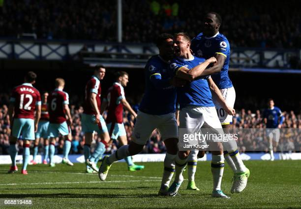 Phil Jagielka of Everton celebrates scoring his sides first goal with his Everton team mates during the Premier League match between Everton and...