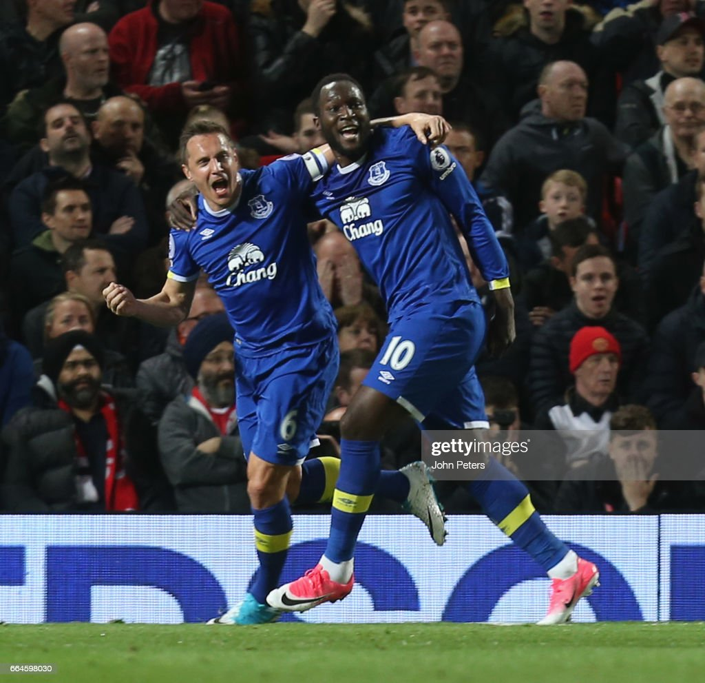 Phil Jagielka of Everton (L) celebrates scoring their first goal during the Premier League match between Manchester United and Everton at Old Trafford on April 4, 2017 in Manchester, England.