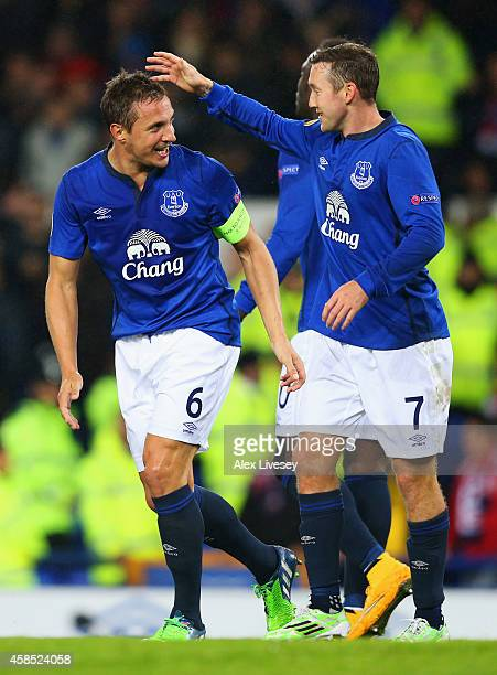 Phil Jagielka of Everton celebrates with Aidan McGeady as he scores their second goal during the UEFA Europa League Group H match between Everton FC...