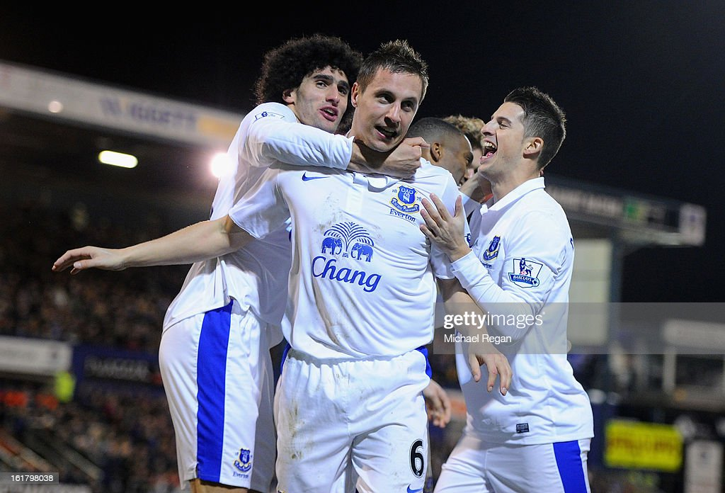 <a gi-track='captionPersonalityLinkClicked' href=/galleries/search?phrase=Phil+Jagielka&family=editorial&specificpeople=682518 ng-click='$event.stopPropagation()'>Phil Jagielka</a> of Everton celebrates with his team-mates after soring his team's second goal to make the score 1-2 during the FA Cup with Budweiser Fifth Round match between Oldham Athletic and Everton at Boundary Park on February 16, 2013 in Oldham, England.