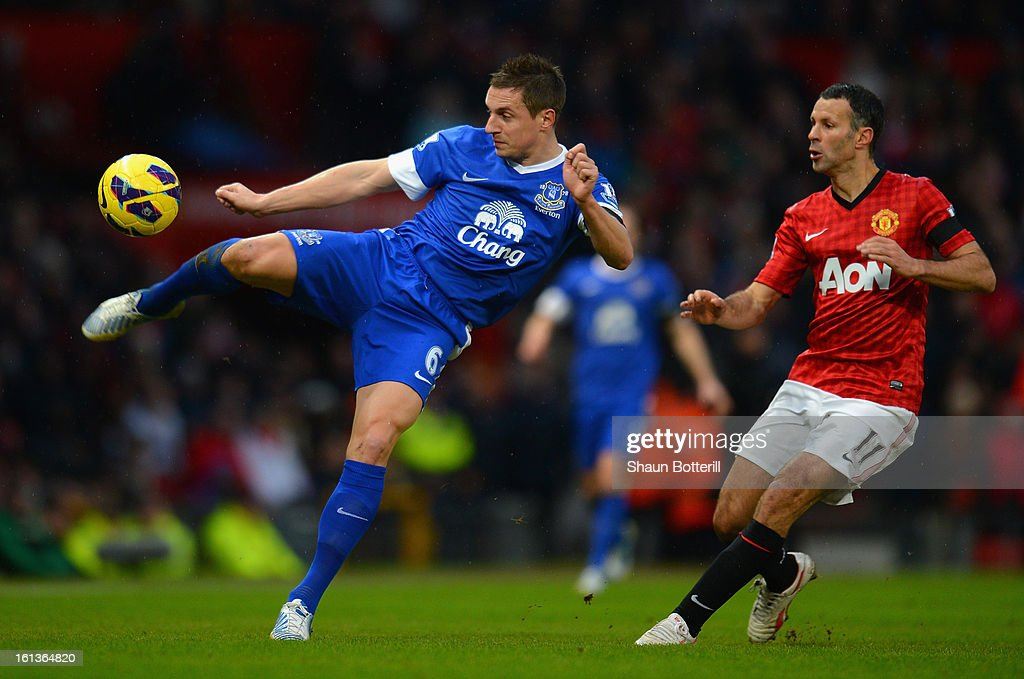 Phil Jagielka of Everton competes with Ryan Giggs of Manchester United during the Barclays Premier League match between Manchester United and Everton at Old Trafford on February 10, 2013 in Manchester, England.