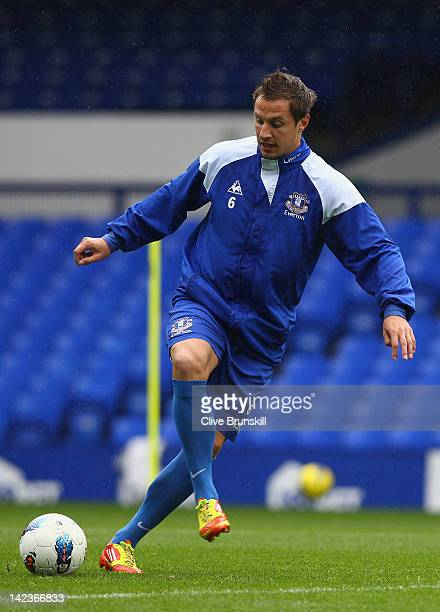 Phil Jagielka of Everton in action during an Everton training session at Goodison Park on April 3 2012 in Liverpool England
