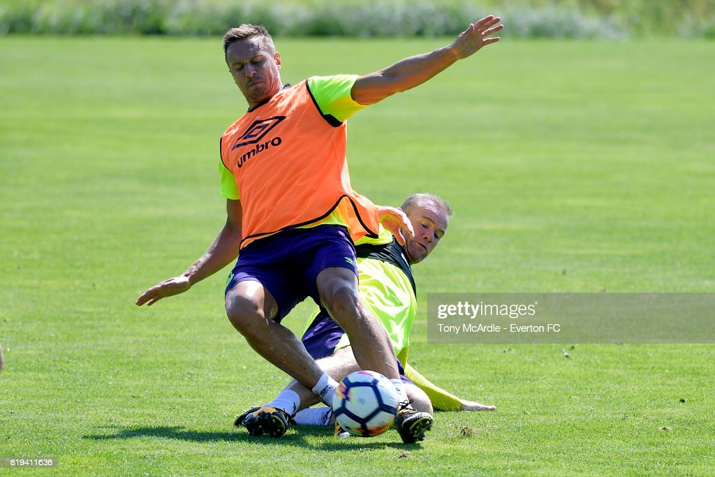 Phil Jagielka of Everton (L) is challenged by team mate Wayne Rooney during pre-season training on July 18, 2017 in De Lutte, Netherlands.