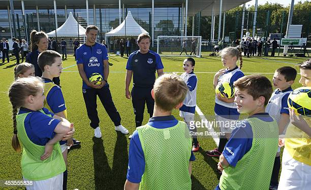 Phil Jagielka of Everton participates in a training session with youngsters during the Official Premier League Season Launch Media Event at Capital...