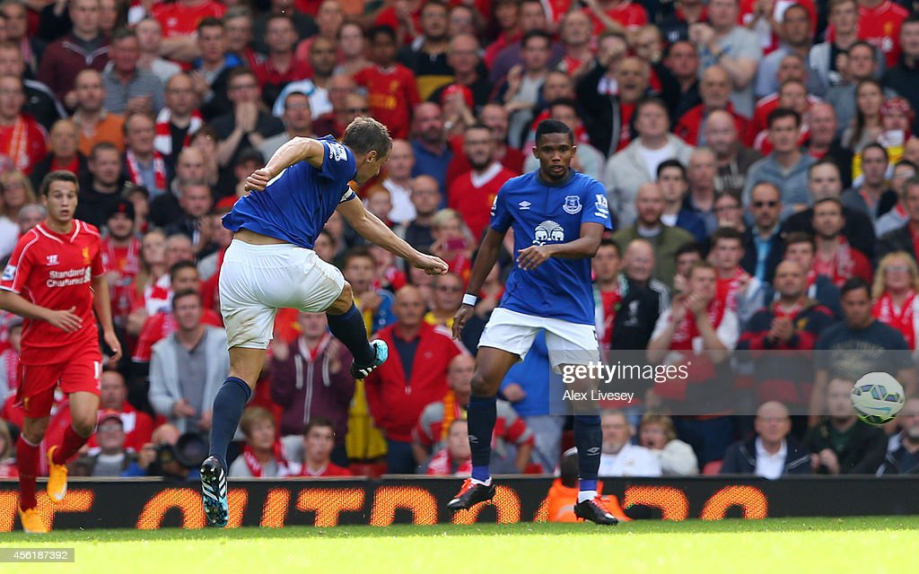 <a gi-track='captionPersonalityLinkClicked' href=/galleries/search?phrase=Phil+Jagielka&family=editorial&specificpeople=682518 ng-click='$event.stopPropagation()'>Phil Jagielka</a> of Everton scores a late goal to level the scores at 1-1 during the Barclays Premier League match between Liverpool and Everton at Anfield on September 27, 2014 in Liverpool, England.