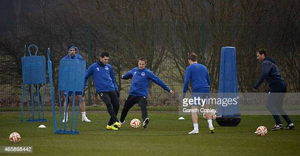 Phil Jagielka of Everton tackles Antolin Alcaraz during a training session at Finch Farm on March 11 2015 in Halewood England