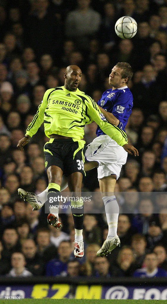 Phil Jagielka (R) of Everton vies with N