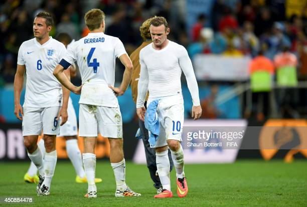 Phil Jagielka Steven Gerrard and Wayne Rooney of England look dejected after 21 defeat by Uruguay in the 2014 FIFA World Cup Brazil Group D match...
