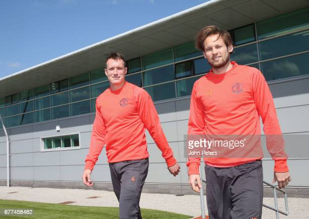 Phil Jones and Daley Blind of Manchester United walk out ahead of a first team training session at Aon Training Complex on May 3 2017 in Manchester...