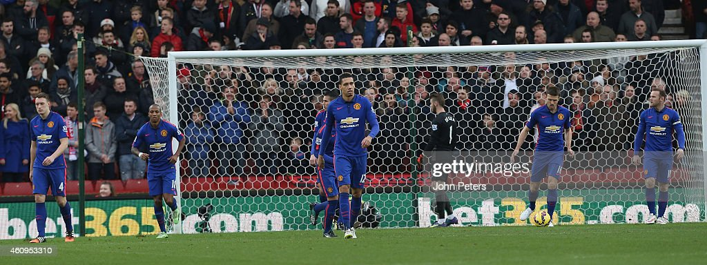 <a gi-track='captionPersonalityLinkClicked' href=/galleries/search?phrase=Phil+Jones+-+Soccer+Player&family=editorial&specificpeople=7841291 ng-click='$event.stopPropagation()'>Phil Jones</a>, <a gi-track='captionPersonalityLinkClicked' href=/galleries/search?phrase=Ashley+Young&family=editorial&specificpeople=623155 ng-click='$event.stopPropagation()'>Ashley Young</a>, <a gi-track='captionPersonalityLinkClicked' href=/galleries/search?phrase=Chris+Smalling&family=editorial&specificpeople=5964313 ng-click='$event.stopPropagation()'>Chris Smalling</a>, <a gi-track='captionPersonalityLinkClicked' href=/galleries/search?phrase=David+de+Gea&family=editorial&specificpeople=3000749 ng-click='$event.stopPropagation()'>David de Gea</a>, <a gi-track='captionPersonalityLinkClicked' href=/galleries/search?phrase=Michael+Carrick&family=editorial&specificpeople=214599 ng-click='$event.stopPropagation()'>Michael Carrick</a> and <a gi-track='captionPersonalityLinkClicked' href=/galleries/search?phrase=Wayne+Rooney&family=editorial&specificpeople=157598 ng-click='$event.stopPropagation()'>Wayne Rooney</a> of Manchester United react to conceding a goal during the Barclays Premier League match between Stoke City and Manchester United at Britannia Stadium on January 1, 2015 in Stoke on Trent, England.