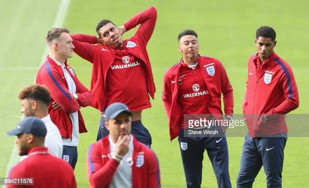 Phil Jones Chris Smalling Jesse Lingard and Marcus Rashford of England in discussion as they walk on the pitch on the eve of their FIFA World Cup...