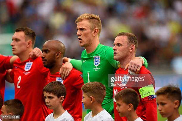 Phil Jones Fabian Delph Joe Hart and Wayne Rooney of England observe the national anthem during the UEFA EURO 2016 Qualifier between Slovenia and...