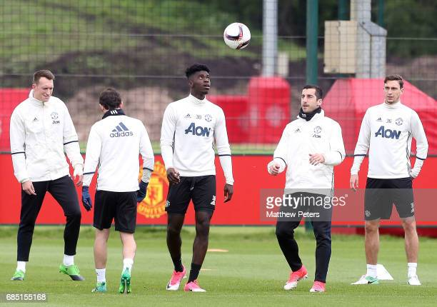 Phil Jones Juan Mata Axel Tuanzebe Henrikh Mkhitaryan and Matteo Darmian of Manchester United in action during a first team training session at Aon...