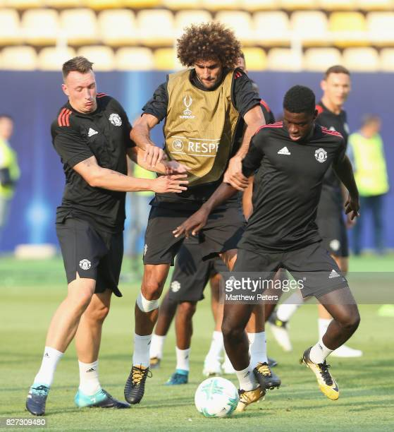 Phil Jones Marouane Fellaini and Axel Tuanzebe of Manchester United in action during a training session ahead of the UEFA Super Cup match between...