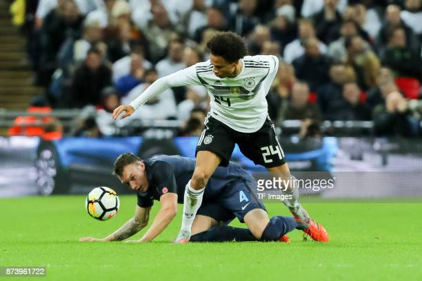 Phil Jones of England and Leroy Sane of Germany battle for the ball during the international friendly match between England and Germany at Wembley...