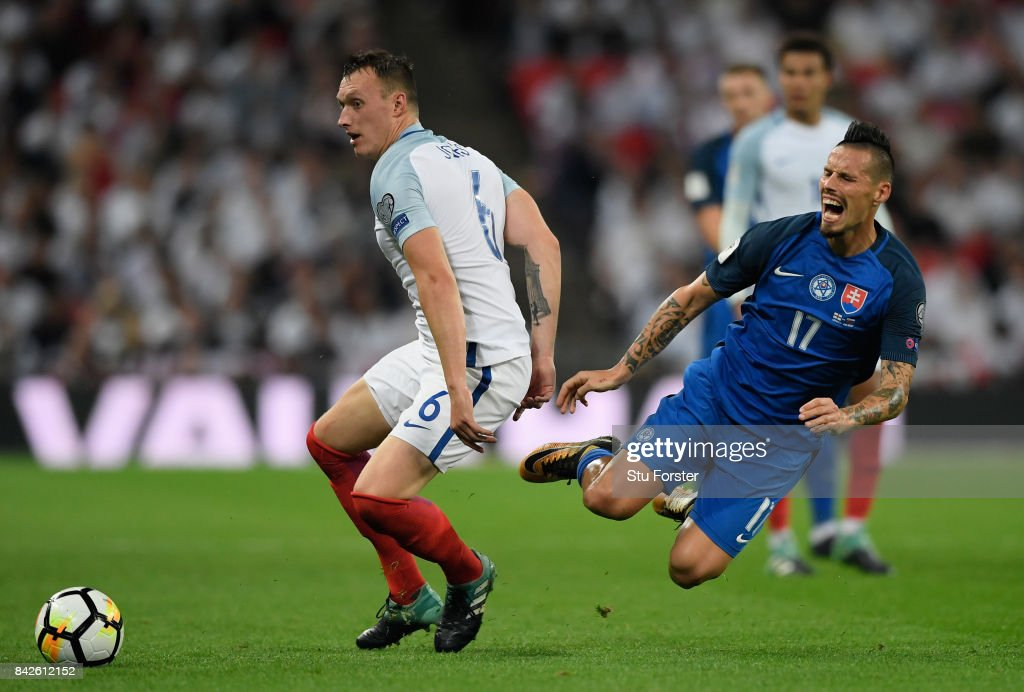 Phil Jones of England challenges Marek Hamsik of Slovakia during the FIFA 2018 World Cup Qualifier between England and Slovakia at Wembley Stadium on September 4, 2017 in London, England.