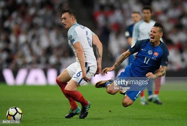 Phil Jones of England challenges Marek Hamsik of Slovakia during the FIFA 2018 World Cup Qualifier between England and Slovakia at Wembley Stadium on...