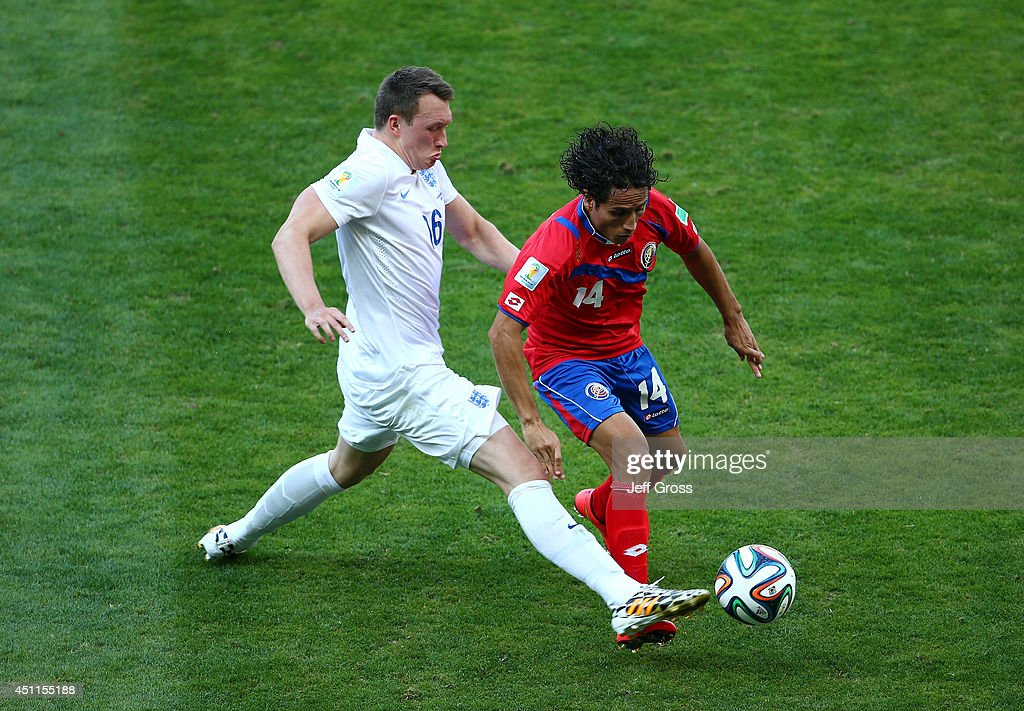 Phil Jones of England challenges <a gi-track='captionPersonalityLinkClicked' href=/galleries/search?phrase=Randall+Brenes&family=editorial&specificpeople=2275484 ng-click='$event.stopPropagation()'>Randall Brenes</a> of Costa Rica during the 2014 FIFA World Cup Brazil Group D match between Costa Rica and England at Estadio Mineirao on June 24, 2014 in Belo Horizonte, Brazil.
