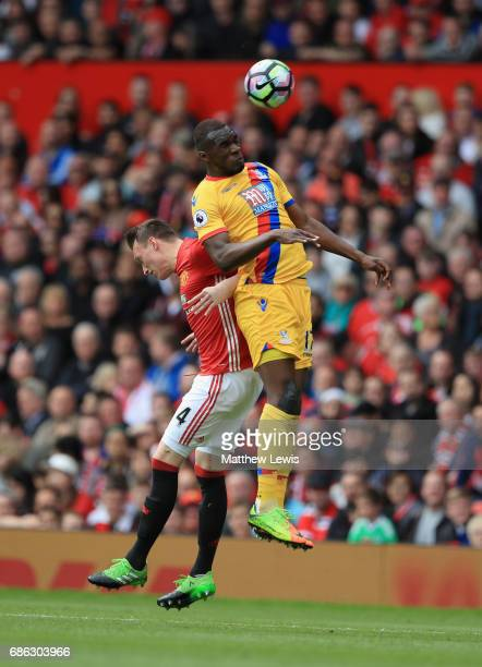 Phil Jones of Manchester United and Christian Benteke of Crystal Palace in action during the Premier League match between Manchester United and...