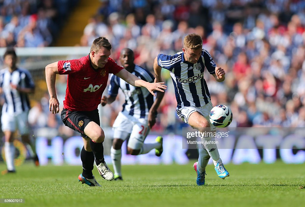 Phil Jones of Manchester United and James Morrison of West Bromwich Albion