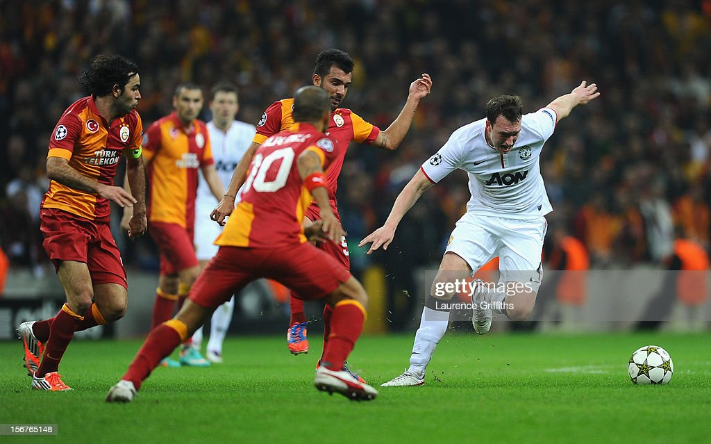 Phil Jones of Manchester United battles with Engin Baytar of Galatasary during the UEFA Champions League Group H match between Galatasaray and Manchester United at the Turk Telekom Arena on November 20, 2012 in Istanbul, Turkey.