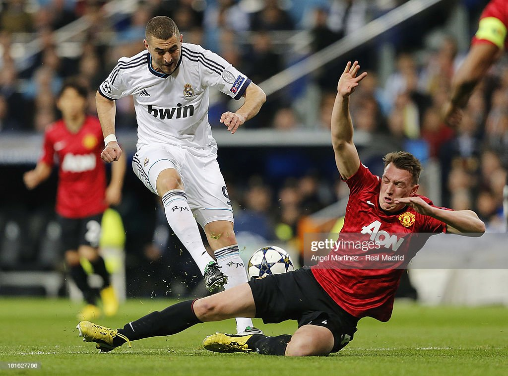 Phil Jones of Manchester United blocks a shot from Karim Benzema of Real Madrid during the UEFA Champions League Round of 16 first leg match between Real Madrid and Manchester United at Estadio Santiago Bernabeu on February 13, 2013 in Madrid, Spain.