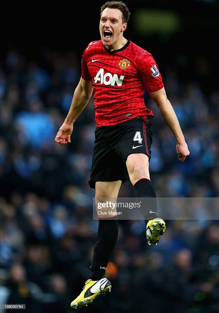 Phil Jones of Manchester United celebrates at the end of the Barclays Premier League match between Manchester City and Manchester United at Etihad Stadium on December 9, 2012 in Manchester, England.