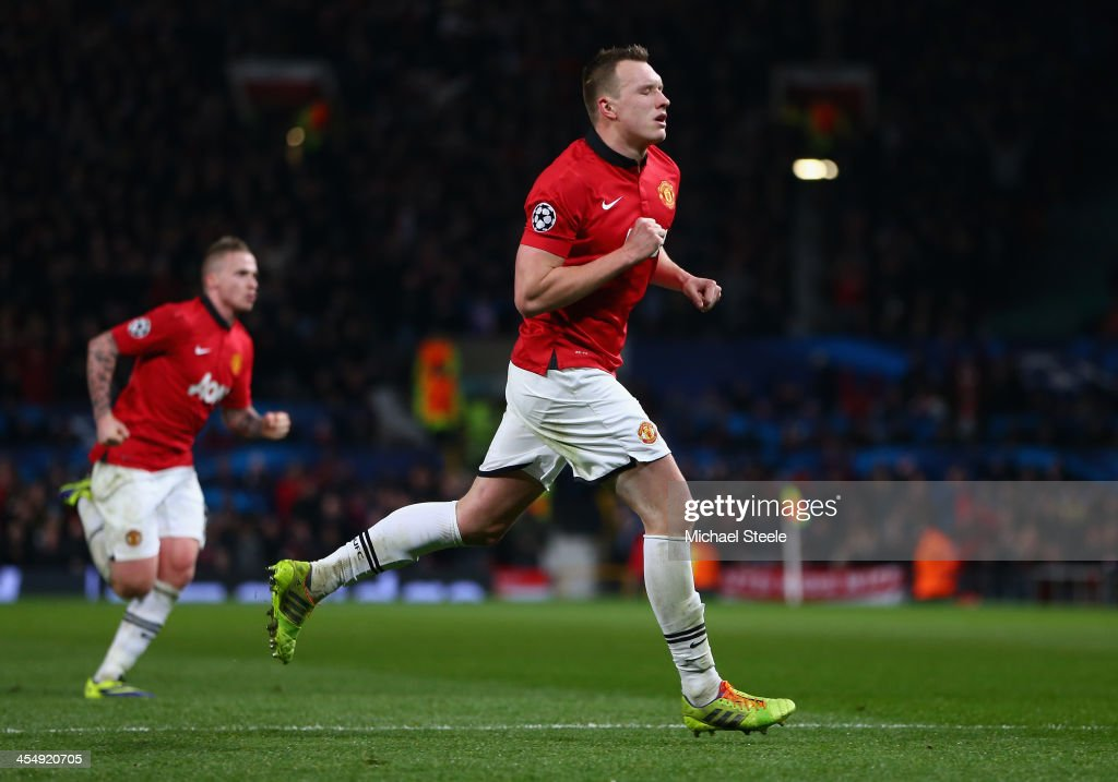Phil Jones of Manchester United celebrates scoring the opening goal during the UEFA Champions League Group A match between Manchester United and Shakhtar Donetsk at Old Trafford on December 10, 2013 in Manchester, England.