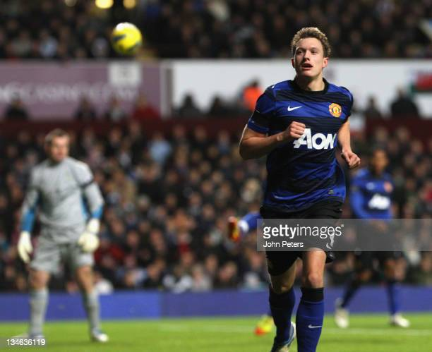 Phil Jones of Manchester United celebrates scoring their first goal during the Barclays Premier League match between Aston Villa and Manchester...