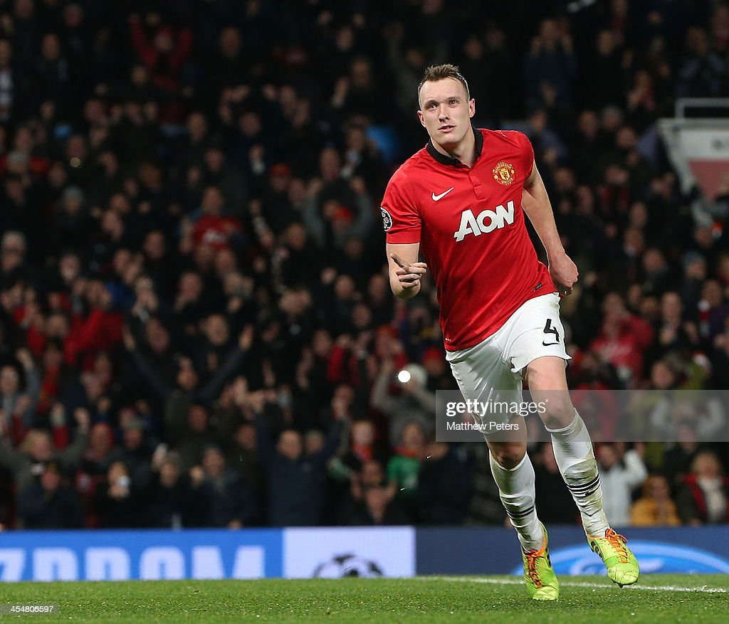 Phil Jones of Manchester United celebrates scoring their first goal during the UEFA Champions League Group A match between Manchester United and Shakhtar Donetsk at Old Trafford on December 10, 2013 in Manchester, England.