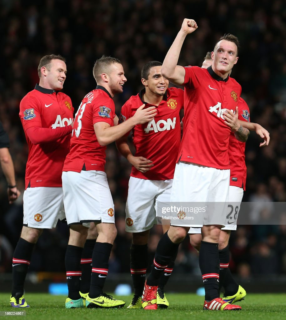Phil Jones (R) of Manchester United celebrates scoring their third goal during the Capital One Cup Fourth Round match between Manchester United and Norwich City at Old Trafford on October 29, 2013 in Manchester, England.