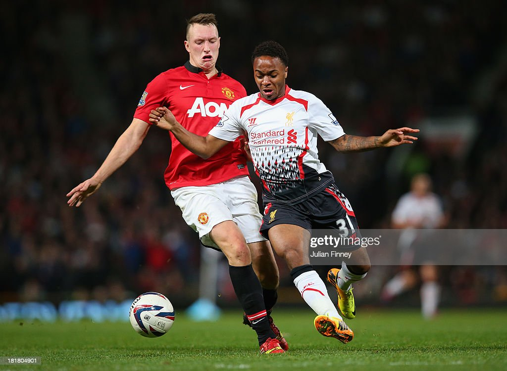 Phil Jones of Manchester United competes with Raheem Sterling of Liverpool during the Capital One Cup Third Round match betwen Manchester United and Liverpool at Old Trafford on September 25, 2013 in Manchester, England.