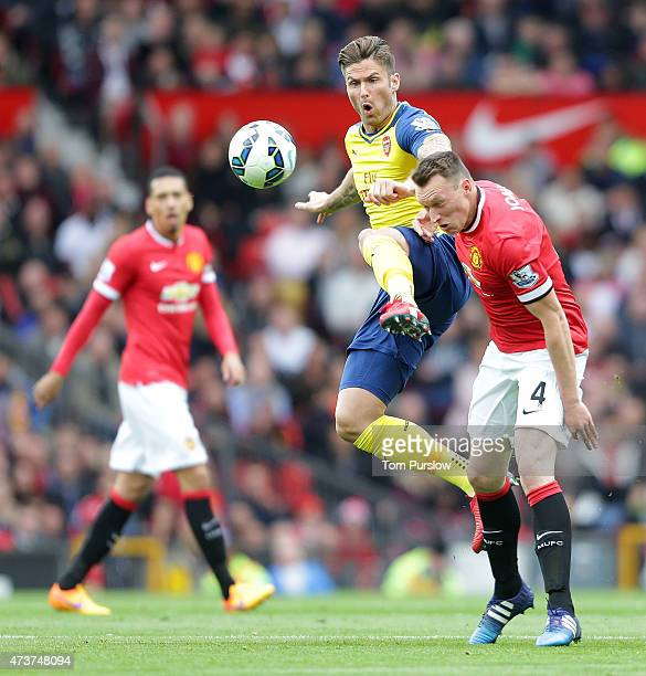 Phil Jones of Manchester United in action with Nacho Monreal of Arsenal during the Barclays Premier League match between Manchester United and...