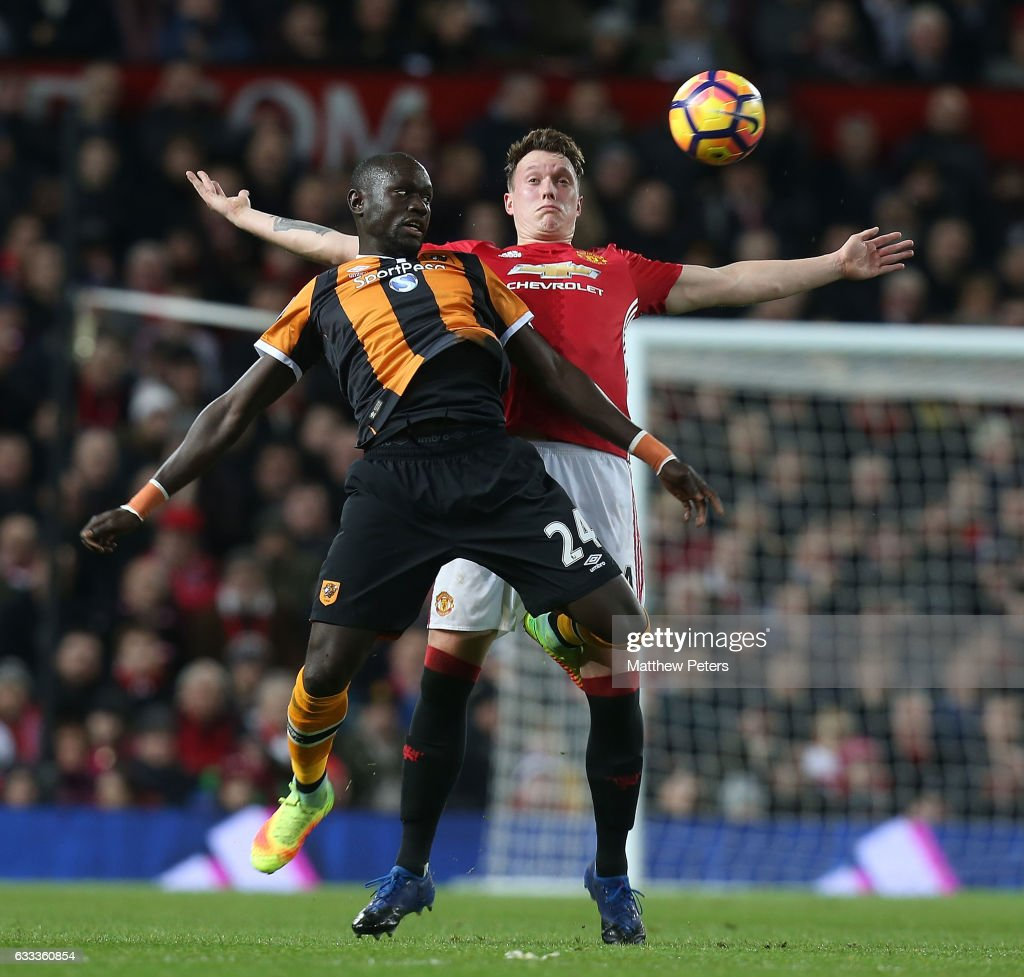 Phil Jones of Manchester United in action with Omar Niasse of Hull City during the Premier League match between Manchester United and Hull City at Old Trafford on February 1, 2017 in Manchester, England.