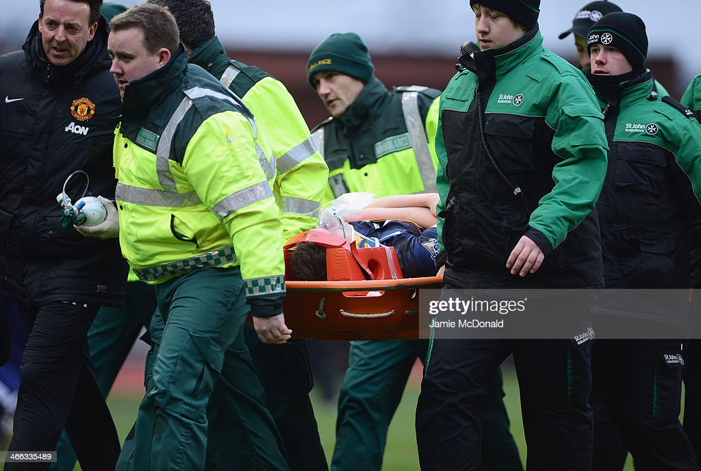 Phil Jones of Manchester United leaves the field on a stretcher during the Barclays Premier League match between Stoke City and Manchester United at Britannia Stadium on February 1, 2014 in Stoke on Trent, England.