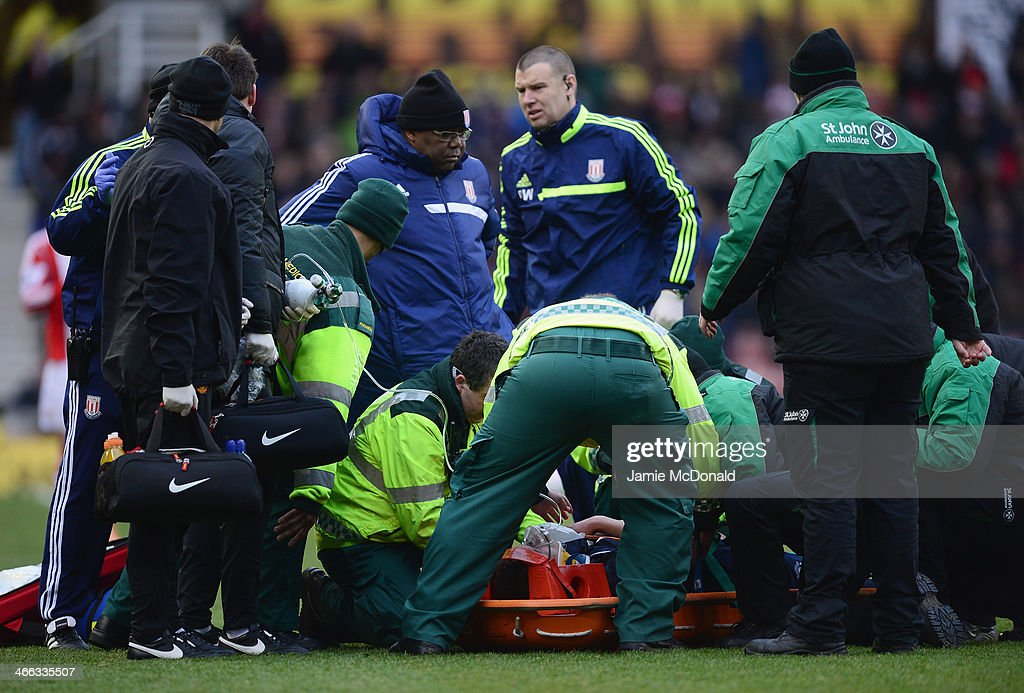 Phil Jones of Manchester United receives treatment before leaving the field on a stretcher during the Barclays Premier League match between Stoke City and Manchester United at Britannia Stadium on February 1, 2014 in Stoke on Trent, England.