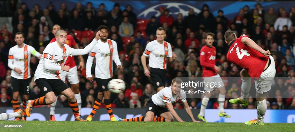 Phil Jones of Manchester United scores their first goal during the UEFA Champions League Group A match between Manchester United and Shakhtar Donetsk at Old Trafford on December 10, 2013 in Manchester, England.