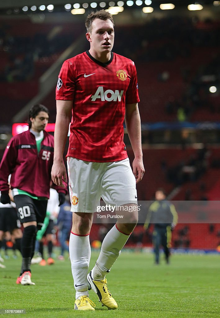 Phil Jones of Manchester United shows his disappointment after the UEFA Champions League Group H match between Manchester United and CFR 1907 Cluj at Old Trafford on December 5, 2012 in Manchester, England.
