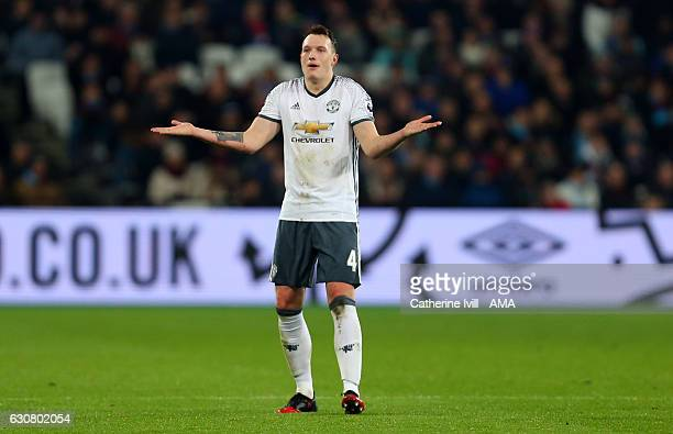 Phil Jones of Manchester United shrugs his shoulders during the Premier League match between West Ham United and Manchester United at London Stadium...