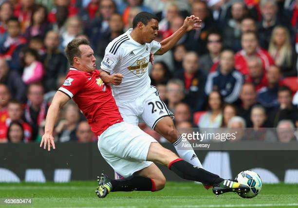 Phil Jones of Manchester United tackles Jefferson Montero of Swansea City during the Barclays Premier League match between Manchester United and...