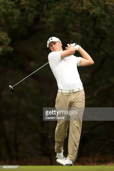Phil Jordan Spieth tees off on the 14th during Round One of the Valero Texas Open at the ATT Oaks Course on March 27 2014 in San Antonio Texas