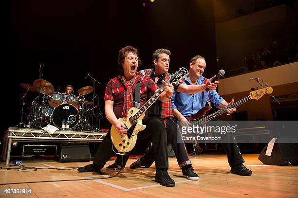 Phil Kennedy Les McKeown and lan Longmuir of the Bay City Rollers perform on stage at Waterfront Hall on February 6 2015 in Belfast United Kingdom