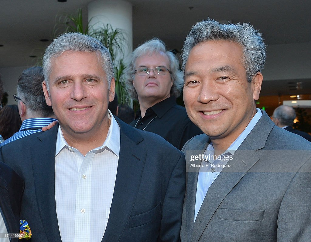 Phil Kent, Chairman and CEO Turner Broadcasting and Kevin Tsujihara, CEO Warner Bros. attend TNT's 25th Anniversary Party at The Beverly Hilton Hotel on July 24, 2013 in Beverly Hills, California.