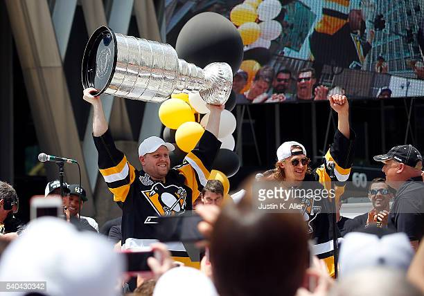 Phil Kessel and Carl Hagelin of the Pittsburgh Penguins celebrate during the Victory Parade and Rally on June 15 2016 in Pittsburgh Pennsylvania
