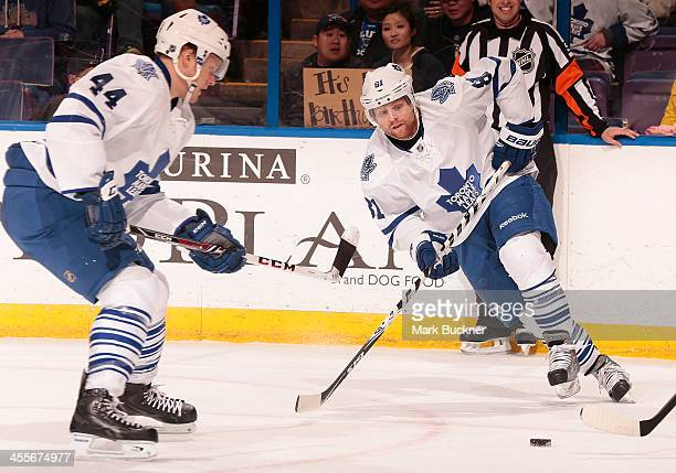 Phil Kessel and Morgan Rielly of the Toronto Maple Leafs skates against the St Louis Blues during an NHL game on December 12 2013 at Scottrade Center...